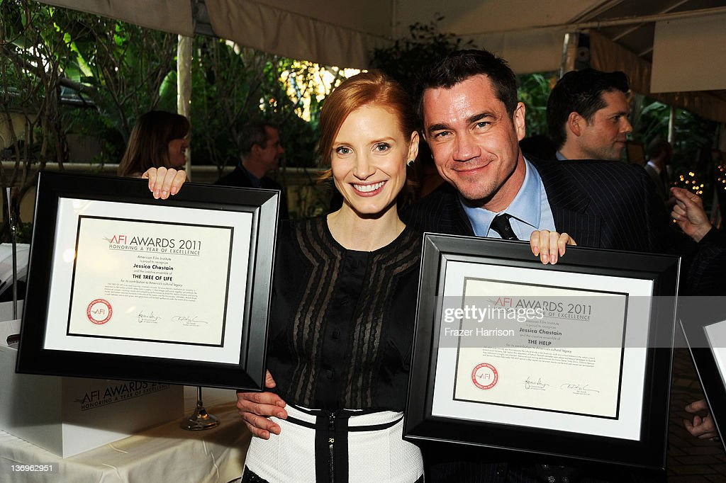 Actress Jessica Chastain and Director Tate Taylor pose with the Year of Excellence Awards for 'The Help' and 'Tree of Life' during the 12th Annual...