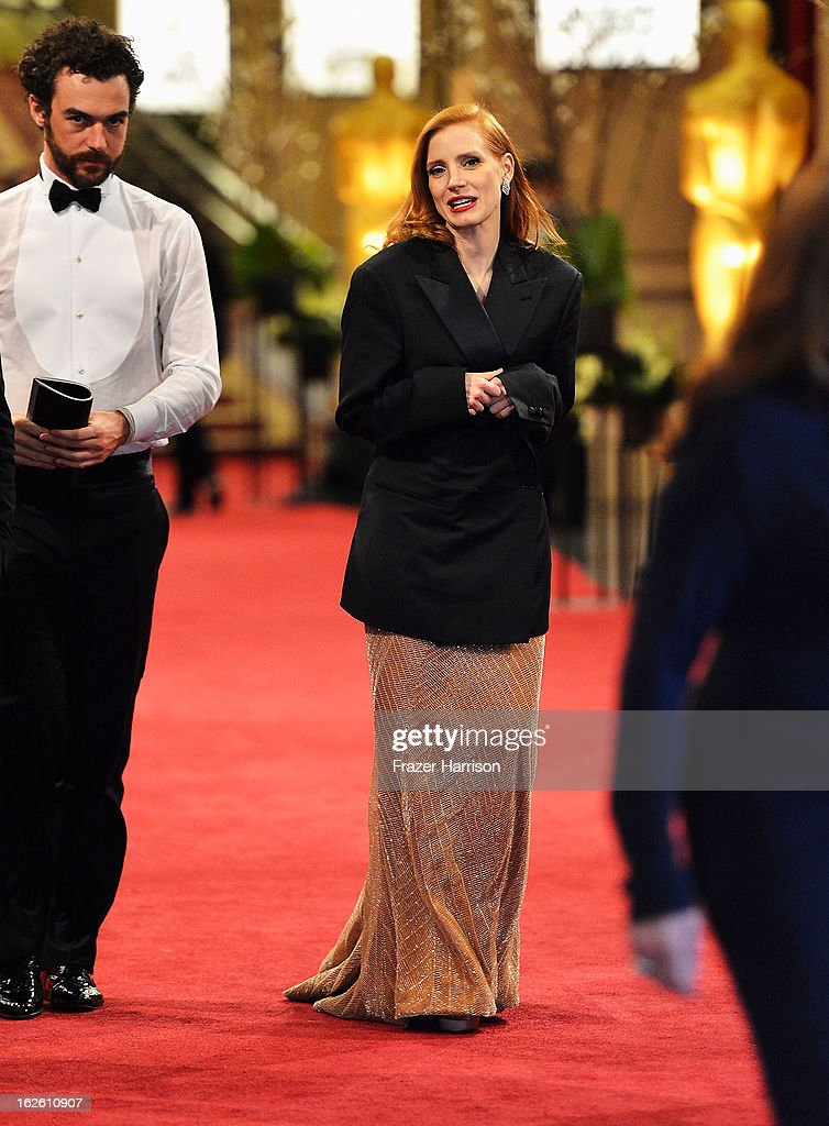 Actress Jessica Chastain and Gian Luca Passi de Preposulo depart the Oscars at Hollywood & Highland Center on February 24, 2013 in Hollywood, California.