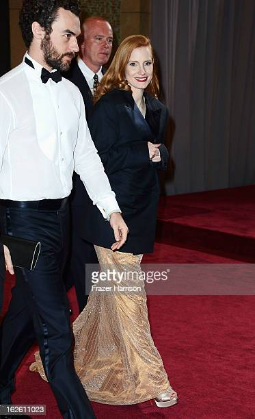 Actress Jessica Chastain and Gian Luca Passi de Preposulo depart the Oscars at Hollywood Highland Center on February 24 2013 in Hollywood California