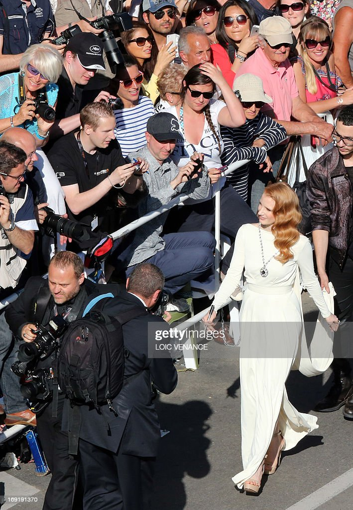 US actress Jessica Chastain greets fans on May 21, 2013 as she arrives for the screening of the film 'Cleopatra' presented in Cannes Classics at the 66th edition of the Cannes Film Festival in Cannes. Cannes, one of the world's top film festivals, opened on May 15 and will climax on May 26 with awards selected by a jury headed this year by Hollywood legend Steven Spielberg.