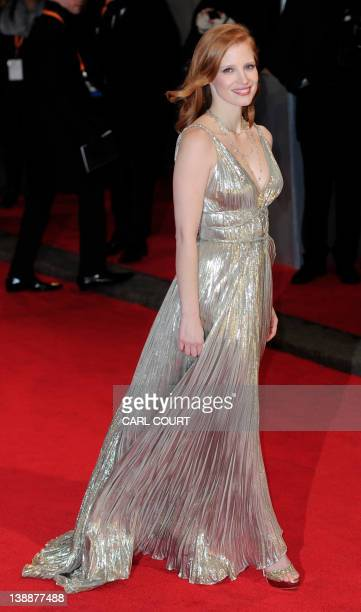 US actress Jessica Chastain poses on the red carpet arriving at the BAFTA British Academy Film Awards at the Royal Opera House in London on February...
