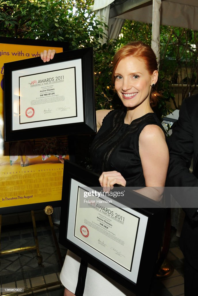 Actress Jessica Chastain poses with the Year of Excellence Awards for 'The Help' and 'Tree of Life' during the 12th Annual AFI Awards held at the...