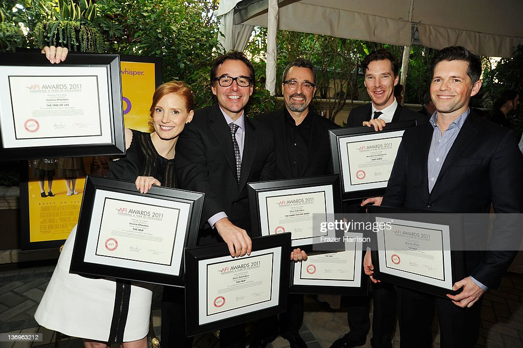Actress Jessica Chastain poses with the Year of Excellence Awards for 'The Help' and 'Tree of Life' Producer Chris Columbus poses with the Year of...