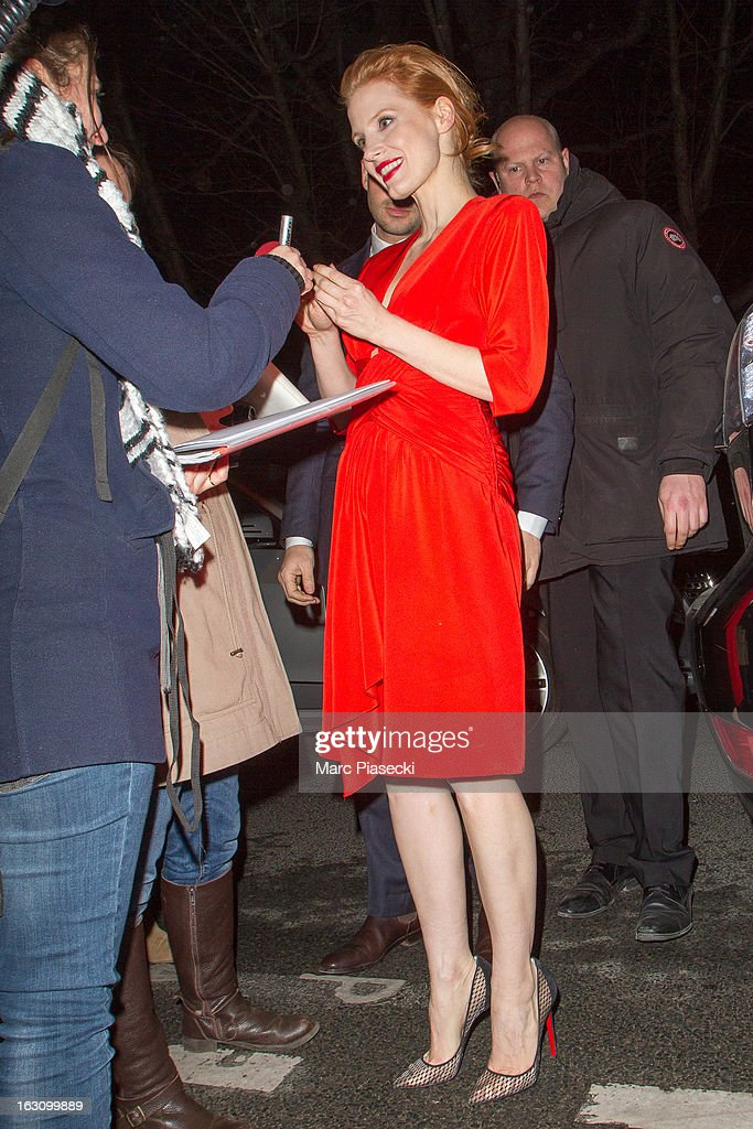 Actress <a gi-track='captionPersonalityLinkClicked' href=/galleries/search?phrase=Jessica+Chastain&family=editorial&specificpeople=653192 ng-click='$event.stopPropagation()'>Jessica Chastain</a> signs autographs as she arrives to attend the 'Saint Laurent' Fall/Winter 2013 Ready-to-Wear show as part of Paris Fashion Week on March 4, 2013 in Paris, France.