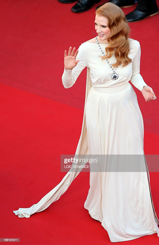 US actress Jessica Chastain waves on May 21, 2013 as she arrives for the screening of the film 'Cleopatra' presented in Cannes Classics at the 66th edition of the Cannes Film Festival in Cannes. Cannes, one of the world's top film festivals, opened on May 15 and will climax on May 26 with awards selected by a jury headed this year by Hollywood legend Steven Spielberg. AFP PHOTO / LOIC VENANCE