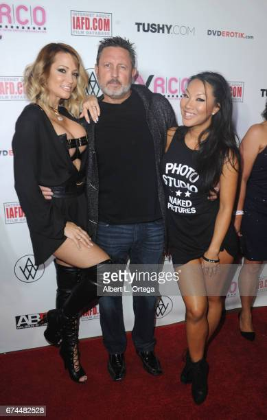 Actress Jessica Drake director/husband Brad Armstrong and actress Asa Akira arrive for the 33rd Annual XRCO Awards Show held at OHM Nightclub on...
