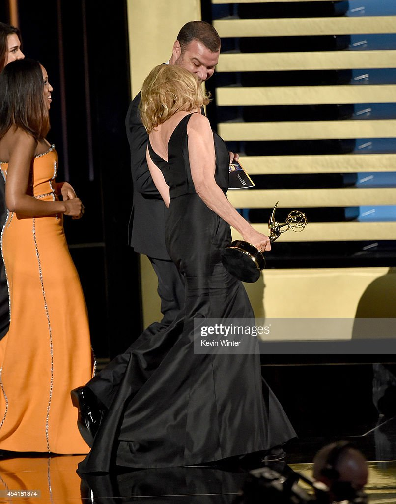 Actress Jessica Lange (C) accepts Outstanding Lead Actress in a Miniseries or Movie for 'American Horror Story: Coven' from actors Kerry Washington and Liev Schreiber onstage at the 66th Annual Primetime Emmy Awards held at Nokia Theatre L.A. Live on August 25, 2014 in Los Angeles, California.