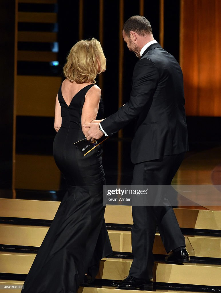 Actress Jessica Lange (L) accepts Outstanding Lead Actress in a Miniseries or Movie for 'American Horror Story: Coven' from actor Liev Schreiber onstage at the 66th Annual Primetime Emmy Awards held at Nokia Theatre L.A. Live on August 25, 2014 in Los Angeles, California.