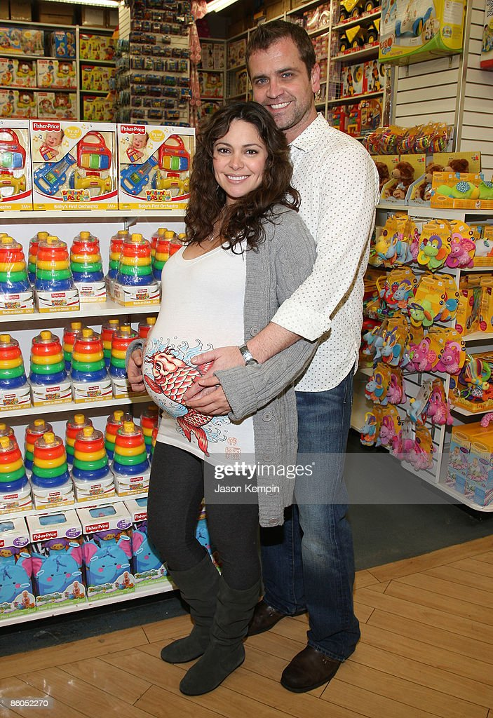Actress Jessica Leccia and husband Brian Malloy shop at Buy Buy Baby on April 20, 2009 in New York City.