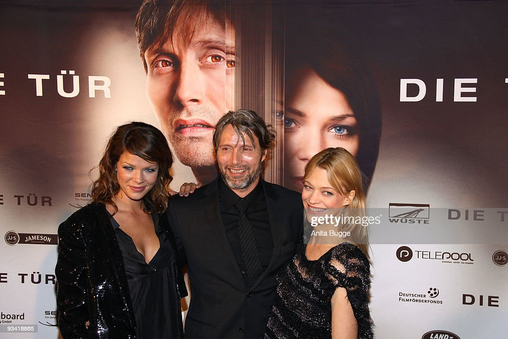 Actress Jessica Schwarz actor Mads Mikkelsen and actress Heike Makatsch arrive at the Germany film premiere of 'Die Tuer' at Kulturbrauerei on...