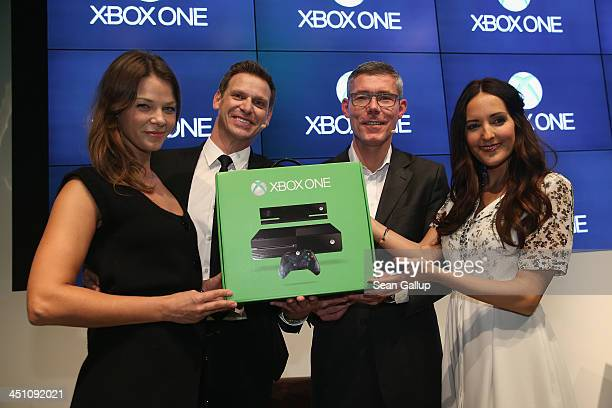 Actress Jessica Schwarz Microsoft Germany Consumer Channel Group General Manager Oliver Kaltner Microsoft Germany head Christian Illek and Johanna...