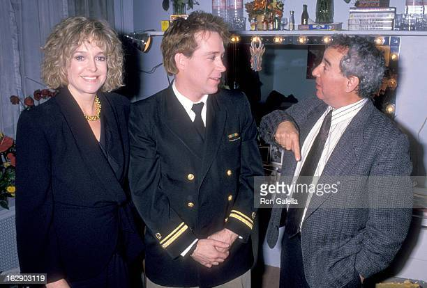 Actress Jill Eikenberry actor Tom Hulce and actor Michael Tucker pose for photographs backstage at 'A Few Good Men' Play Performance on November 22...