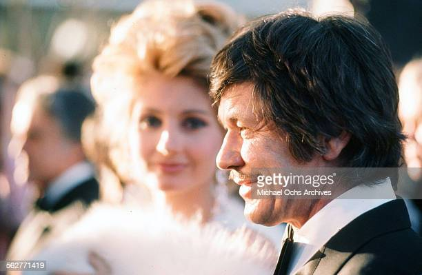 Actress Jill Ireland and actor Charles Bronson arrive to the 46th Academy Awards at Dorothy Chandler Pavilion in Los AngelesCalifornia