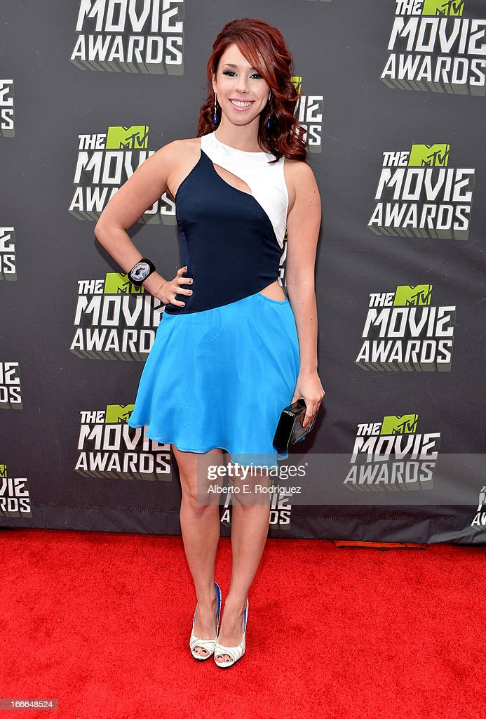 Actress Jillian Rose Reed arrives at the 2013 MTV Movie Awards at Sony Pictures Studios on April 14, 2013 in Culver City, California.