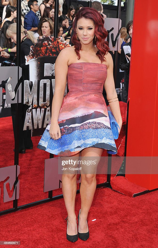 Actress <a gi-track='captionPersonalityLinkClicked' href=/galleries/search?phrase=Jillian+Rose+Reed&family=editorial&specificpeople=7430633 ng-click='$event.stopPropagation()'>Jillian Rose Reed</a> arrives at the 2014 MTV Movie Awards at Nokia Theatre L.A. Live on April 13, 2014 in Los Angeles, California.