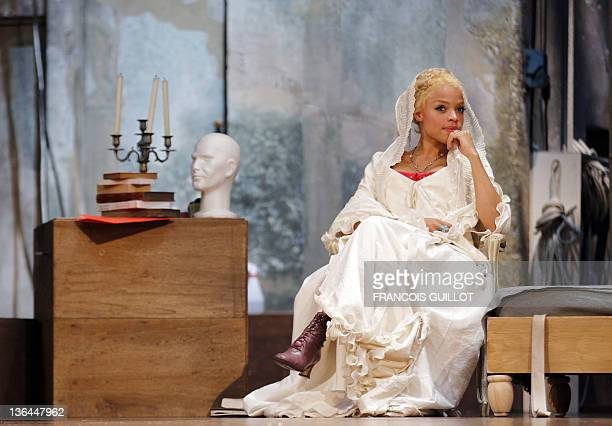 Actress Jina Djemba performing as Madame de Tourvel rehearse during the photocall of US John Malkovich's theatre play 'Les liaisons dangereuses'...