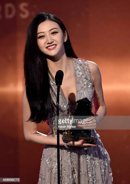 Actress Jing Tian accepts the Hollywood International Award onstage during the 18th Annual Hollywood Film Awards at The Palladium on November 14 2014...