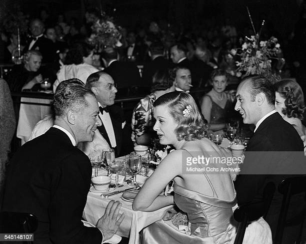 Actress Joan Bennett husband producer Walter Wanger and actor Charles Boyer attend an event in Los Angeles California