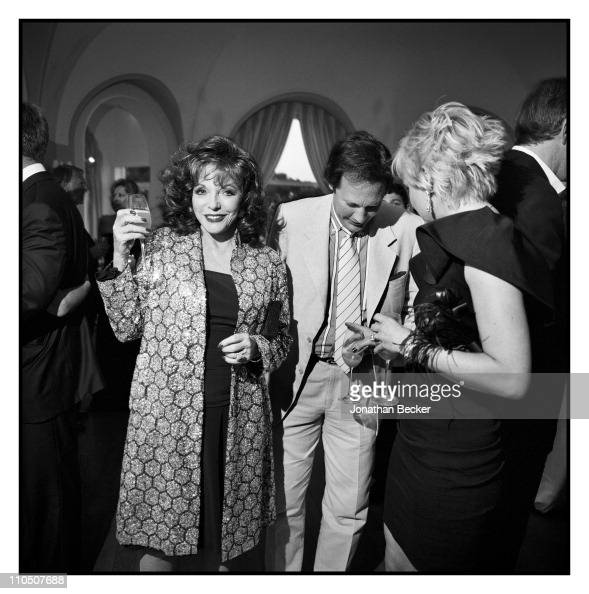 Actress Joan Collins and husband Percy Gibson are photographed at Vanity Fair Cannes Party at the Eden Roc Cap d'Antibes for Vanity Fair Magazine on...
