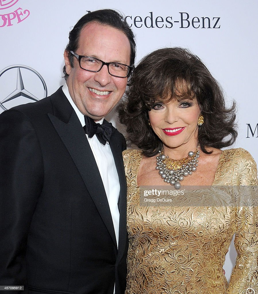 Actress <a gi-track='captionPersonalityLinkClicked' href=/galleries/search?phrase=Joan+Collins&family=editorial&specificpeople=109065 ng-click='$event.stopPropagation()'>Joan Collins</a> and husband <a gi-track='captionPersonalityLinkClicked' href=/galleries/search?phrase=Percy+Gibson&family=editorial&specificpeople=207140 ng-click='$event.stopPropagation()'>Percy Gibson</a> arrive at the 2014 Carousel Of Hope Ball Presented By Mercedes-Benz at The Beverly Hilton Hotel on October 11, 2014 in Beverly Hills, California.