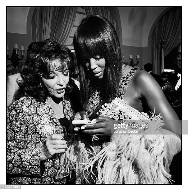 Actress Joan Collins and model Naomi Campbell are photographed at Vanity Fair Cannes Party at the Eden Roc Cap d'Antibes for Vanity Fair Magazine on...