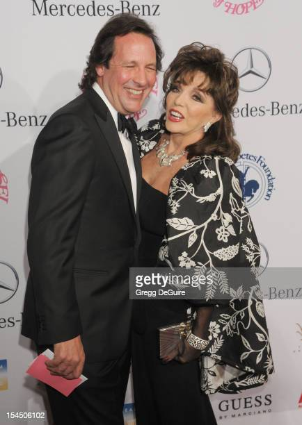 Actress Joan Collins and Percy Gibson arrive at the 26th Anniversary Carousel Of Hope Ball presented by MercedesBenz at The Beverly Hilton Hotel on...