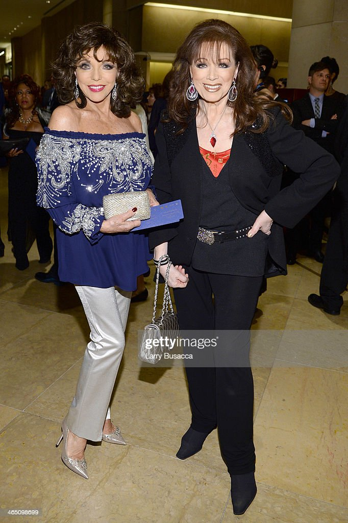 Actress Joan Collins (L) and writerJackie Collins attend the 56th annual GRAMMY Awards Pre-GRAMMY Gala and Salute to Industry Icons honoring Lucian Grainge at The Beverly Hilton on January 25, 2014 in Beverly Hills, California.