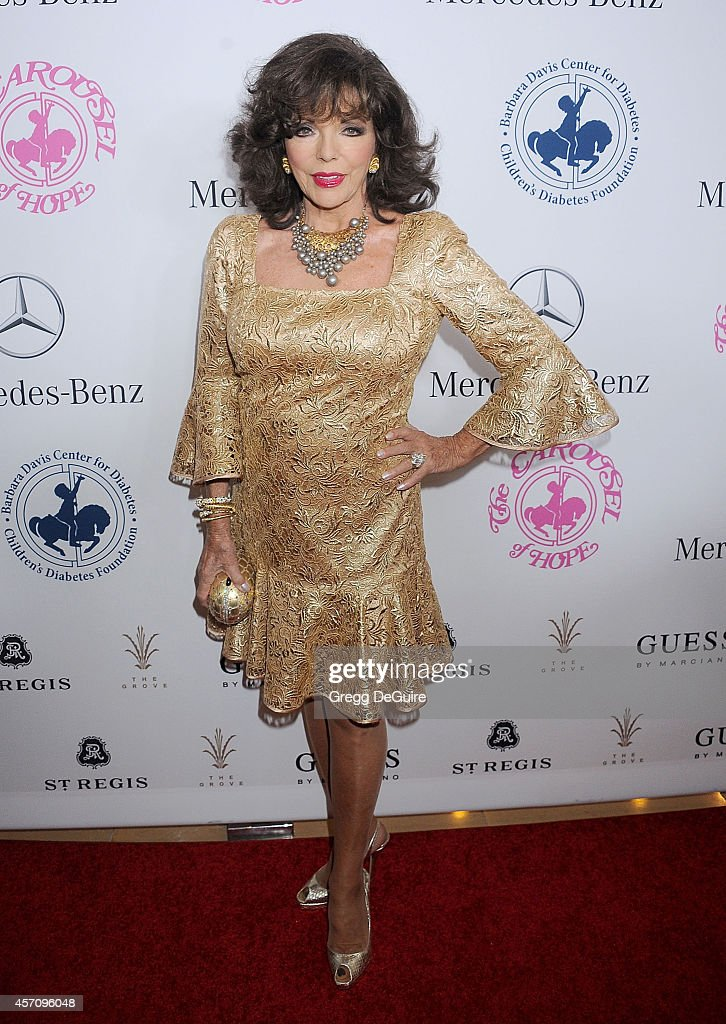 Actress <a gi-track='captionPersonalityLinkClicked' href=/galleries/search?phrase=Joan+Collins&family=editorial&specificpeople=109065 ng-click='$event.stopPropagation()'>Joan Collins</a> arrives at the 2014 Carousel Of Hope Ball Presented By Mercedes-Benz at The Beverly Hilton Hotel on October 11, 2014 in Beverly Hills, California.