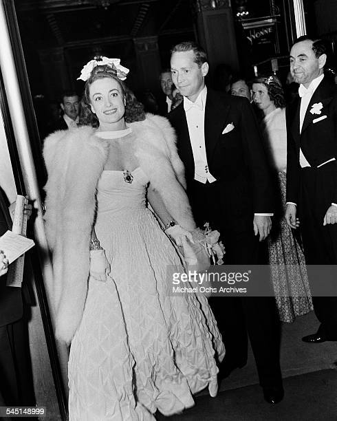 Actress Joan Crawford and husband Franchot Tone arrive at an event in Los Angeles California