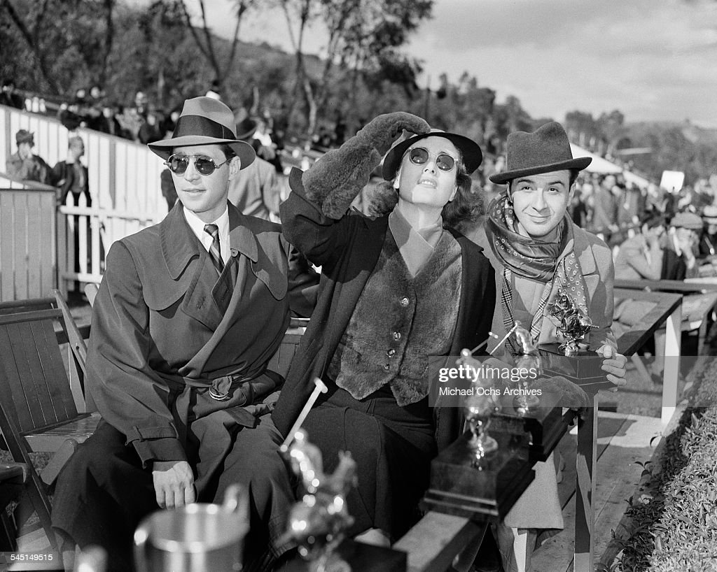 Actress Joan Crawford and husband Franchot Tone attend a polo match in Los Angeles, California.