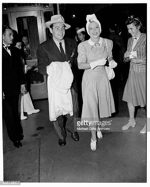 Actress Joan Crawford and husband Phillip Terry arrive at an event in Los Angeles California