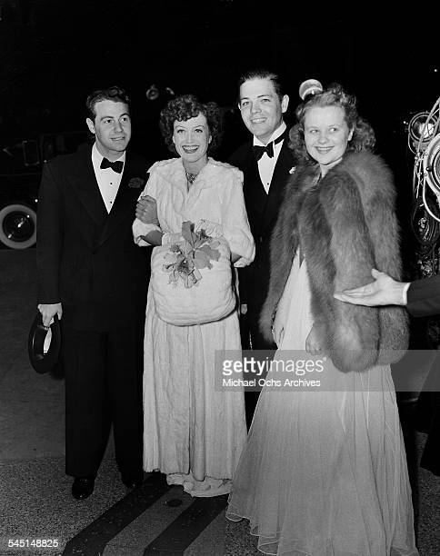 Actress Joan Crawford and husband Phillip Terry arrive at an event with daughter Christina Crawford in Los Angeles California