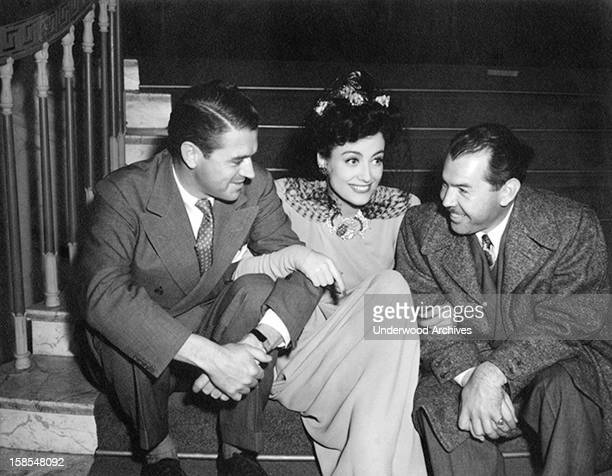 Actress Joan Crawford and two admirers Hollywood California circa 1938
