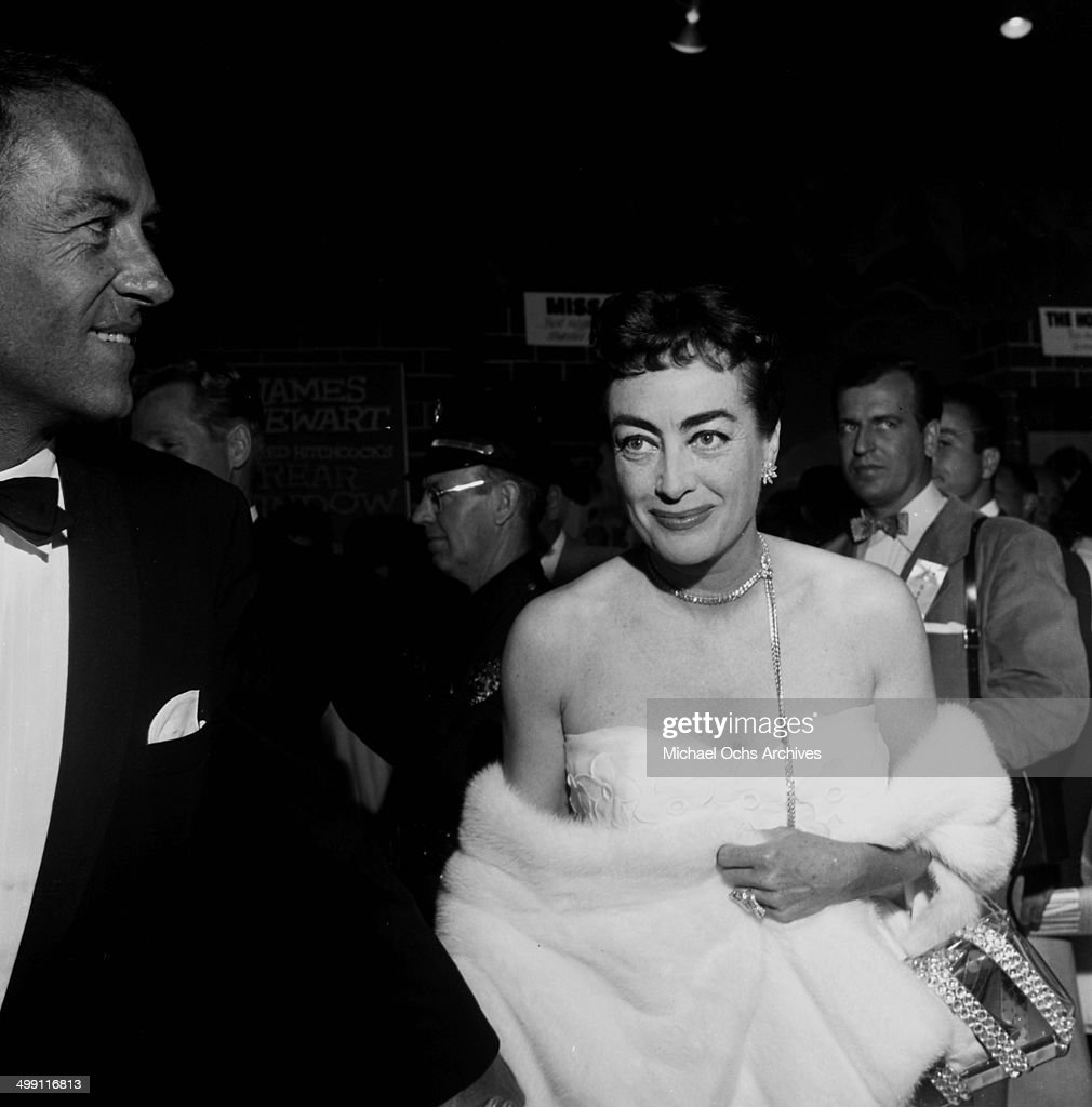 Actress Joan Crawford attend a premiere 'Rear Window' in Los Angeles California