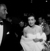 Actress Joan Crawford attend a premiere 'Rear Window' in Los Angeles California