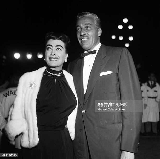 Actress Joan Crawford attend a premiere with Cesar Romero in Los Angeles California
