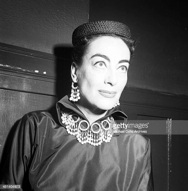 Actress Joan Crawford attends to guest during the 'Joan Crawford Fashion Show' in Los Angeles California