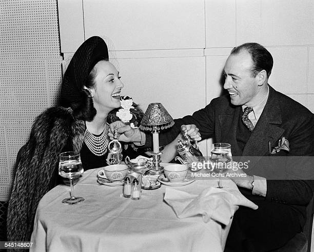 Actress Joan Crawford has lunch with a friend in Los Angeles California