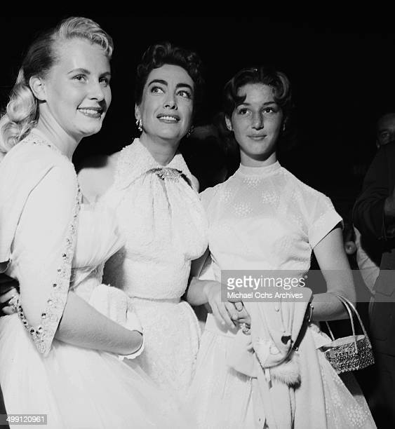 Actress Joan Crawford poses with her young girls in Los Angeles California
