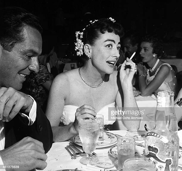 Actress Joan Crawford with Jennings Lang at dinner at the Cocoanut Grove in Los Angeles California