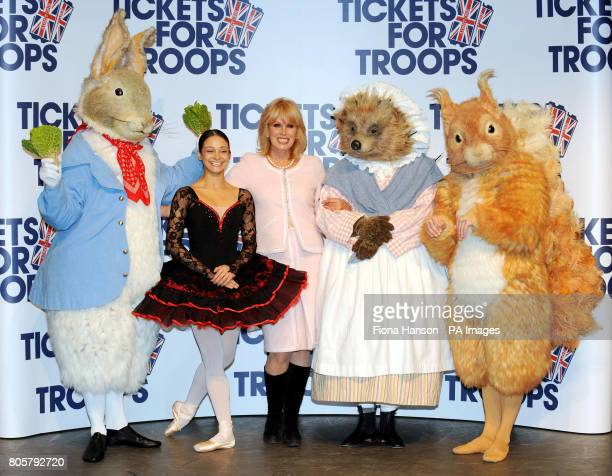Actress Joanna Lumley accompanies Roberta Marquez Principal with the Royal Ballet and character dancers from the tales of Beatrix Potter Peter Rabbit...