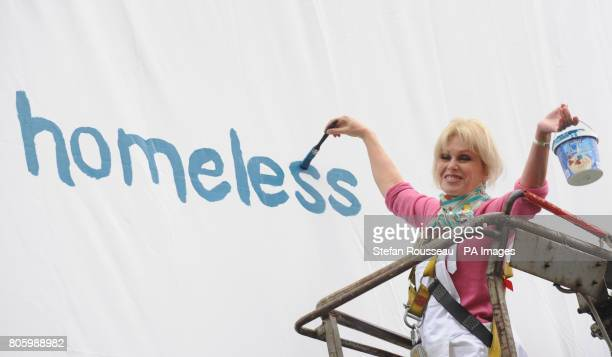 Actress Joanna Lumley helps to paint a billboard in London today advertising the Thames Reach campaign to raise awareness to London's homeless at the...