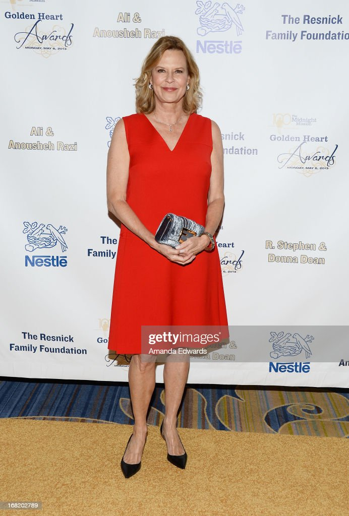 Actress <a gi-track='captionPersonalityLinkClicked' href=/galleries/search?phrase=JoBeth+Williams&family=editorial&specificpeople=792017 ng-click='$event.stopPropagation()'>JoBeth Williams</a> arrives at the Midnight Mission's 'Golden Heart Awards' honoring Tim Allen and Jason Sinay at the Beverly Wilshire Four Seasons Hotel on May 6, 2013 in Beverly Hills, California.
