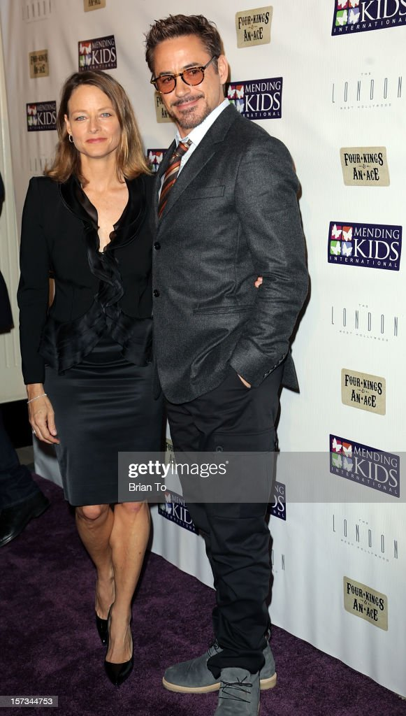 Actress <a gi-track='captionPersonalityLinkClicked' href=/galleries/search?phrase=Jodie+Foster&family=editorial&specificpeople=204488 ng-click='$event.stopPropagation()'>Jodie Foster</a> and actor Robert Downey, Jr. attend Mending Kids International celebrity poker tournament at The London Hotel on December 1, 2012 in West Hollywood, California.