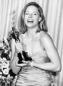 Actress Jodie Foster laughing as she holds her 'Best Actress' Oscar for the film 'The Accused' at the 61st Annual Academy Awards at the Shrine...