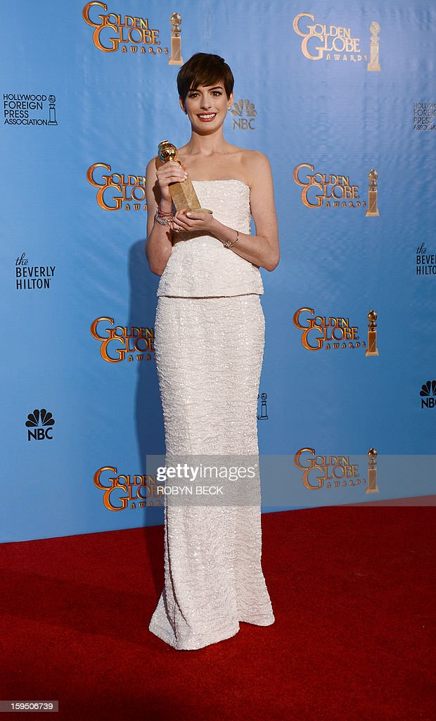 Actress Jodie Foster poses with Cecil B. DeMille Award in the press room during the 70th Annual Golden Globe Awards held at The Beverly Hilton Hotel on January 13, 2013 in Beverly Hills, California. AFP PHOTO/Robyn BECK