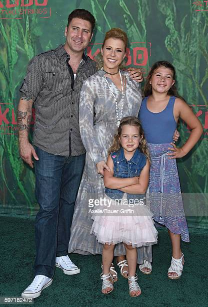 Actress Jodie Sweetin daughters Zoie Laurel May Herpin and Beatrix Carlin Sweetin Coyle and Justin Hodak arrive at the premiere of Focus Features'...