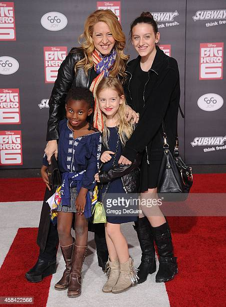 Actress Joely Fisher and kids arrive at the Los Angeles premiere of Disney's 'Big Hero 6' at the El Capitan Theatre on November 4 2014 in Hollywood...