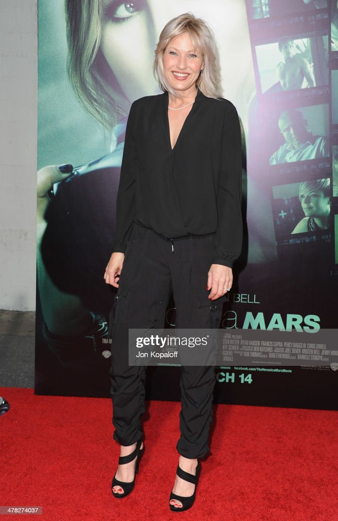 Actress Joey Lauren Adams arrives at the Los Angeles premiere 'Veronica Mars' at TCL Chinese Theatre on March 12 2014 in Hollywood California