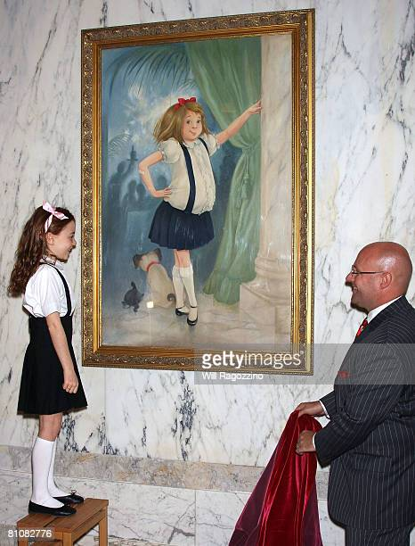 Actress Jordana Beatty and The Plaza general manager Shane Krige attend the unveiling of the famous portrait of Eloise at the Plaza Hotel on May 14...